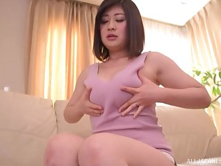 Short haired solo Japanese brunette model Misato Shiori masturbates