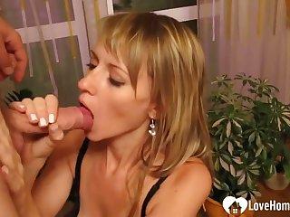 Pretty MILF sucking and eating cum