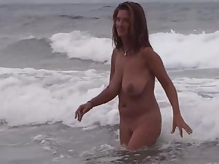 Gorgeous Milf on the beach with boyfriend