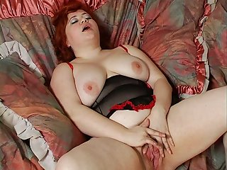 This fatty is one horny ginger babe who loves masturbating hard with her toy