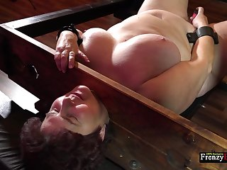 Oversights granny Hana is masturbating pussy in the equipped BDSM room