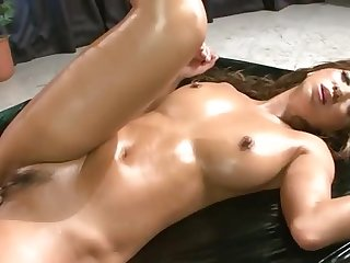Naked, horny and oiled up Japanese hottie is being fucked deeply