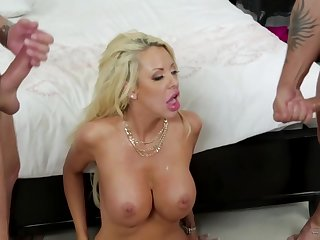 Taylor is a big titted, blonde woman who seems to like how two dicks feel inside her