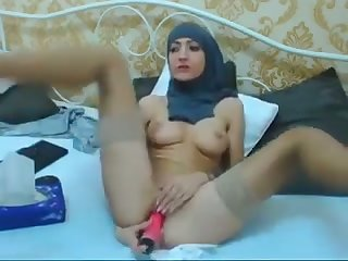 Lusty amateur hijab webcam chick is happy to pet her wet pussy