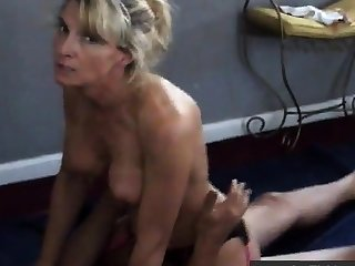 Girl talks dirty while cuckold husband films her with bull