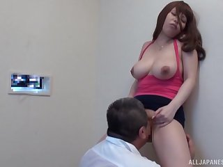 Busty Japanese girl Rion Nishikawa drops on her knees to blow